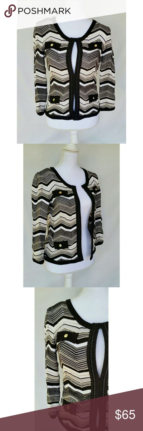 White House Black Market Zig Zag Sweater Jacket White House Black Market Stripe Knit Cardigan. Super comfy! Size small. Excellent like new condition. Sold out online.  Structured knit sweater fills the role of a jacket with a softer manner. Detailed with button-accented faux flap pockets and dressmaker trim, in the neutrals you need.  Classic silhouette. Knit with vertical rows of open pointelle stitches. Satin passementerie trim along the front placket. Soft goldtone accent buttons. White…