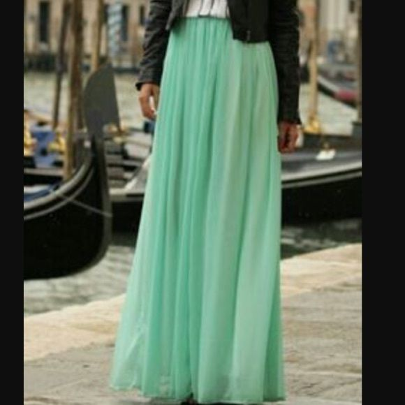 Flowy, sheer maxi skirt in teal This skirt is great for spring!  It's in great condition.  Elastic waist, and floor length sheer fabric with a solid mini skirt under lining.  It has two slit, one one each hip, that go all the way to the top.  Dress it up with pearls, or give it some edge by pairing with a graphic tee and leather jacket.  First photo is a styling suggestion and is not the actual skirt. Moa Skirts Maxi