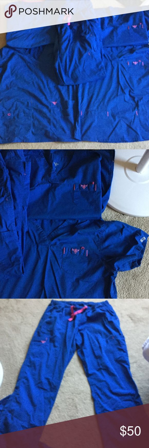 6 piece set of Scrubs royal blue Set comes with 4 tops 2 pants all match both sets of tops are the same.  All med couture brand very well made. Selling very cheap to clean out closet I have a lots of scrubs. Sorry there wrinkled they were in a tote in closet. med couture Other
