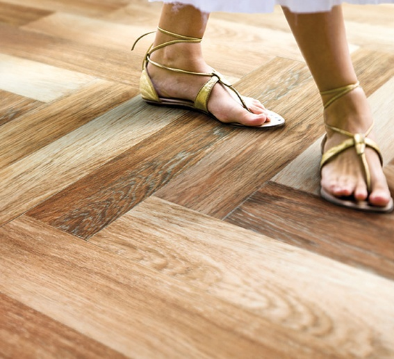 Wood Tiles: Durable porcelain, cheaper than hardwood, and can have a heating element below to keep your toes warm!