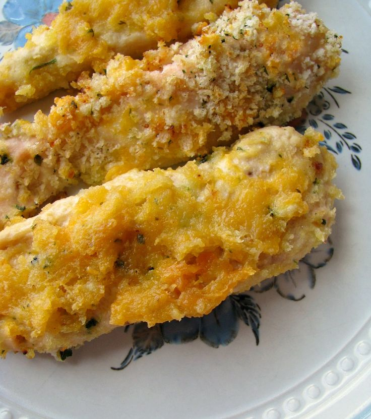 Cheesy baked garlic chicken strips, juicy yogurt dipped chicken breast rolled in cheddar and Parmesan and coated with garlic panko bread crumbs.