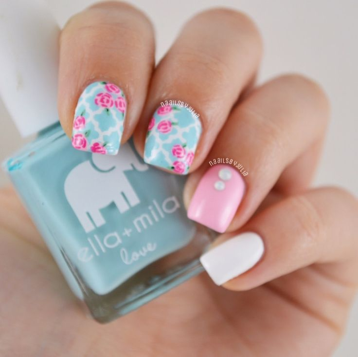 "Lovely Spring manicure by @naailsbyjulia using our Moroccan Nail Stencils, @ellamilapolish ""Beach Resort Blue"" & @serendipitypolish ""Summer Sunnies"", ""Pink Poinsettia"", ""Mint Martini and ""Cash Flow Queen"" all found at snailvinyls.com. Get @serendipitypolish's new white polish, Goal Digger at serendipitypolish.com"