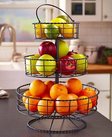 "Save space on your kitchen counter with this 3-Tier Farmhouse Basket. Use it for storage or display. A handle on the top makes it easy to move around. 14"" dia."
