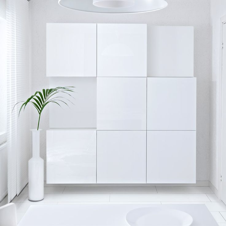 BESTÅ white shelf units with white high-gloss doors