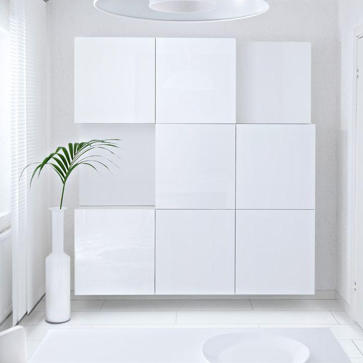 BESTÅ vita hyllor med dörrar i vit högglans