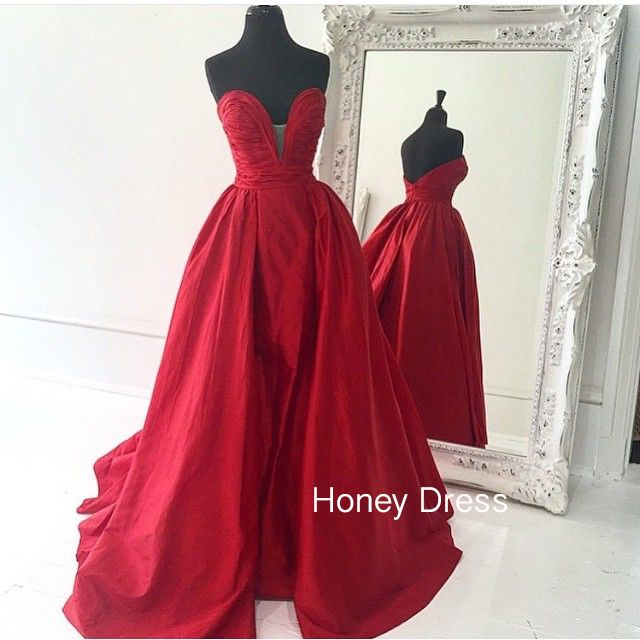 Satin Red Strapless A-line Prom Dress With V-Back Pleats Ruching. This stunning sleeveless ball gown is perfect for any glamorous event.