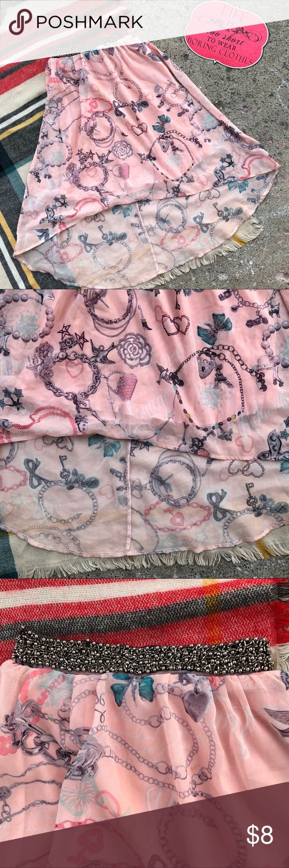 Sheer Paris Skirt with lining and high/low hem A pretty Paris themed skirt with elastic in the waist and a high/low hem. It has a sparkly belt attached to the front waistband. So feminine and beautiful! In good, second-hand condition! ü Bottoms Skirts