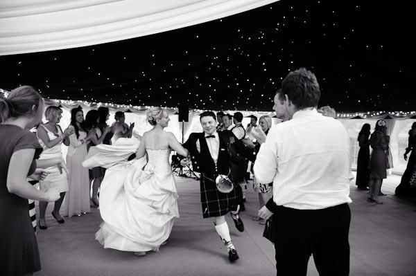 Ceilidh dancing to Licence to Ceilidh at a beautiful Scottish Wedding at Slaugham Place. Look at the Bride and Groom go, they look like seasoned Scottish reelers to me! English country wedding (7)