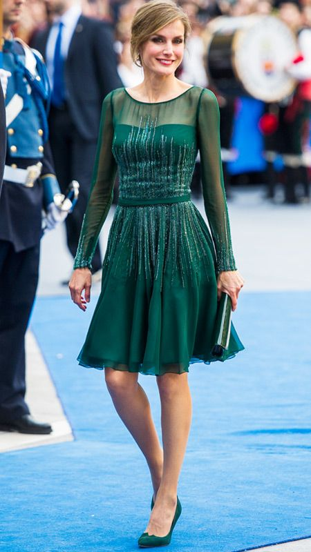 For the Prince of Asturias Awards ceremony in Oviedo, Spain, Letizia wears a glittery emerald Felipe Varela dress with a sheer yoke and long sleeves.