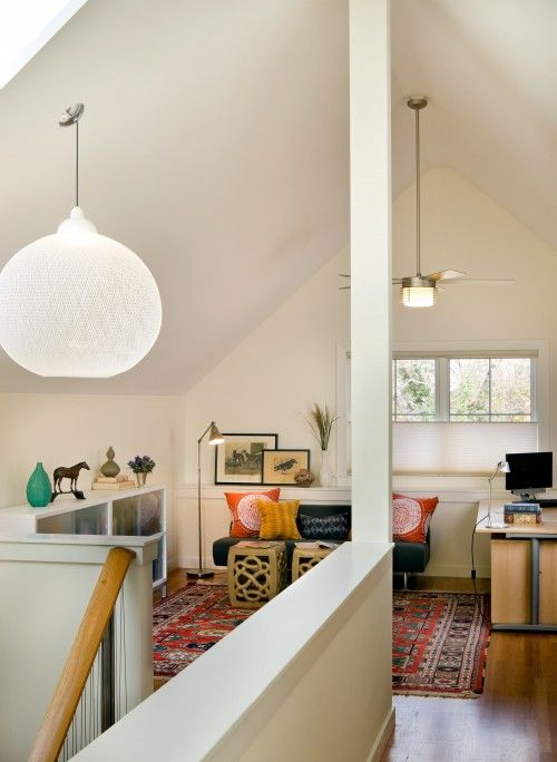 I just love this upstairs family area. A craft room/game room right here would be SO fun!