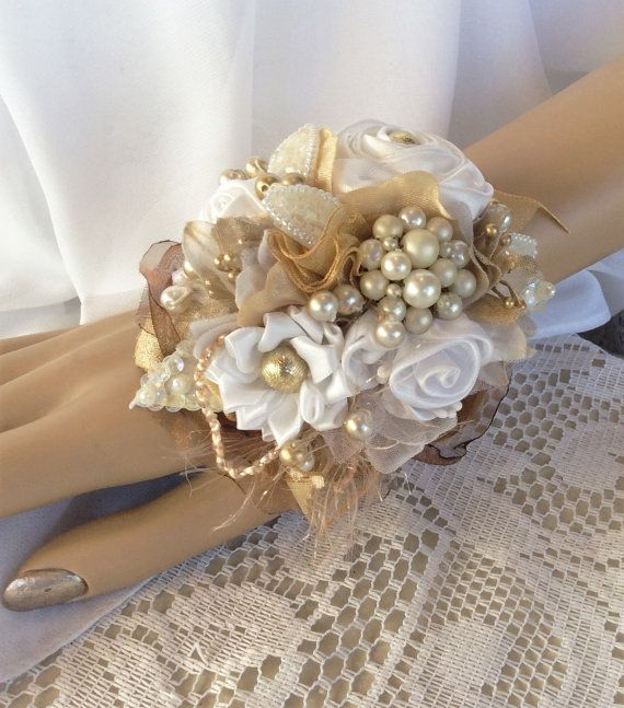 Gold&White Wedding Corsage-Prom Corsage-Brooch Corsage-Wrist Corsage-Jewelry Corsage-Keepsake-Alternative-Fabric Flower Corsage-Prom Flowers  All of our Wrist Corsage are Handmade by my Daughter-Tammy- and Myself,Janice... and each is ONE OF A KIND..Our own styles and designs.  THIS HAS A Pretty Lace BRACELET--NO NEED TO TRY TO TIE IT WITH A STRING...Thats just annoying..and strings dont stay tied..  ZOOM IN FOR ALL THE UNIQUE DETAILS..unlike any others  This is Handmade with Fabric Flowe...