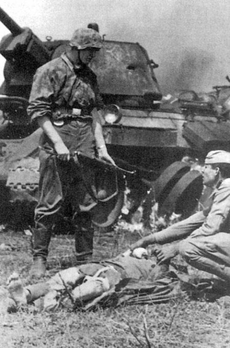 SS soldiers and Soviet prisoners of war  http://albumwar2.com/ss-soldiers-and-soviet-prisoners-of-war/