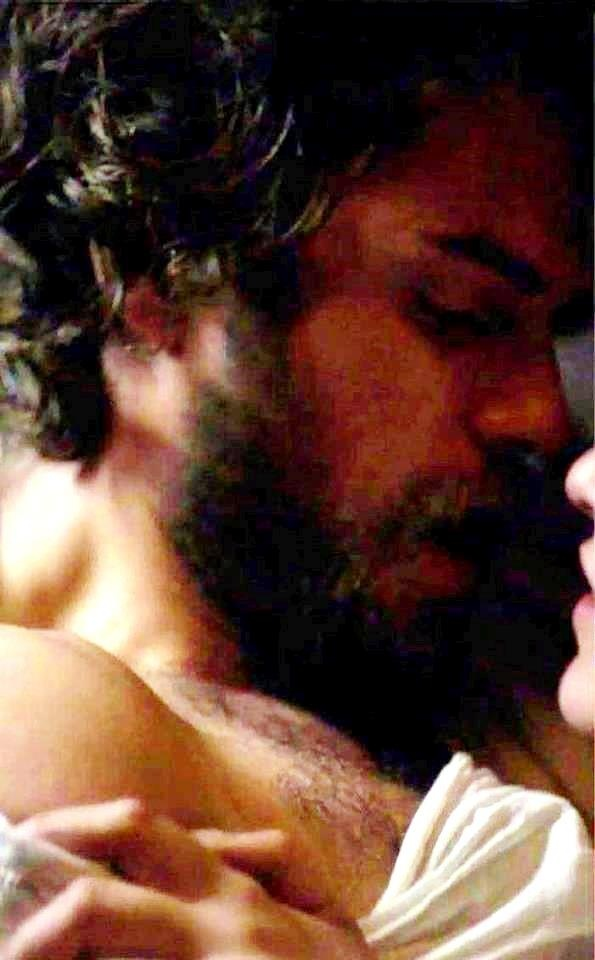 shirt off, beard. long hair. dead.