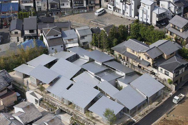 Nishinoyama House designed by Architects Kazuyo Sejima & Associates contains 10 unique apartments with overlapping pitched roofs.