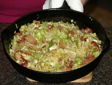 Learn how to make Irish food recipes. This bacon and cabbage recipe is a typical Irish dish. In a Dutch oven or large skillet brown the bacon and then add the cabbage; stir for 5 minutes. Add seasoning and stir.