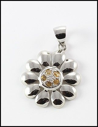 A charming flower shaped pendant, Fine 9 carat white gold surround with quality citrine and diamond gems.