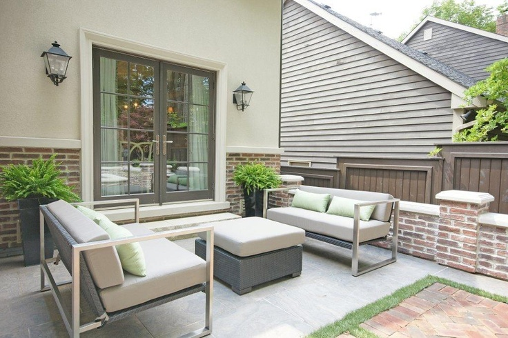 Photo of his modern backyard design with our elegant exterior mouldings in the background.