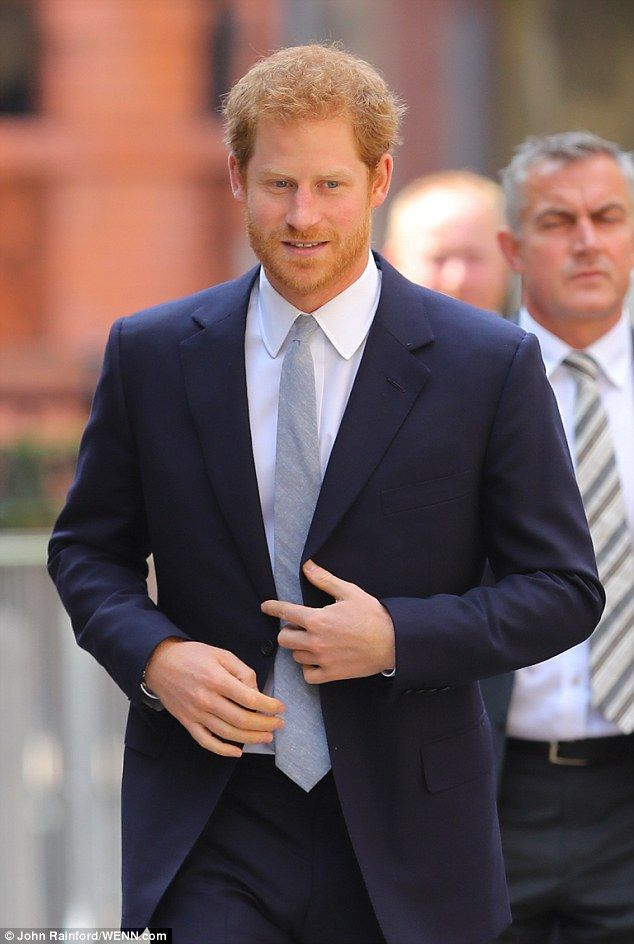 The royal looked dapper in a dark navy suit, teamed with a pale grey tie ...