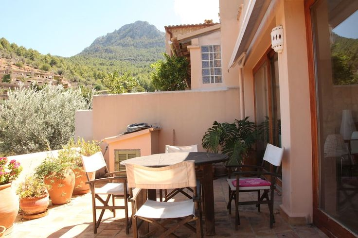 Full terrace on the first floor, with potted garden, eating area, and grand views of the olive filled Northern mountains of Deia., Mallorca. With a view of the Balearic Sea, it's perfect for  star gazing!