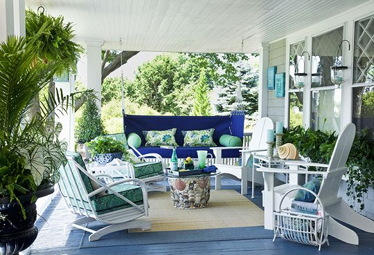 this porch is a dream for a beach or lake house.