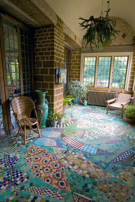 I like the idea of an outdoor mosaic floor but I would want it done in deep jewel tones I think