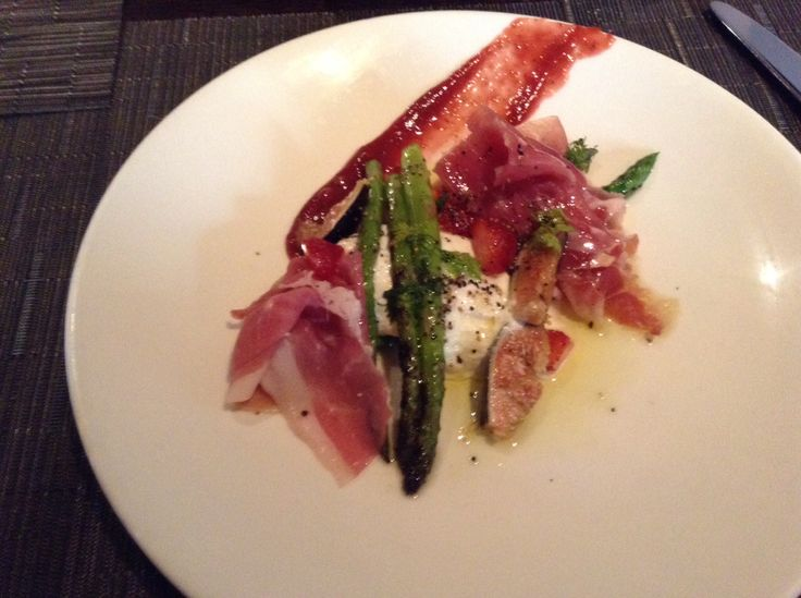 Grilled asparagus with prosciutto and burata cheese with some fig jelly and a little strawberry #Spoonpgh