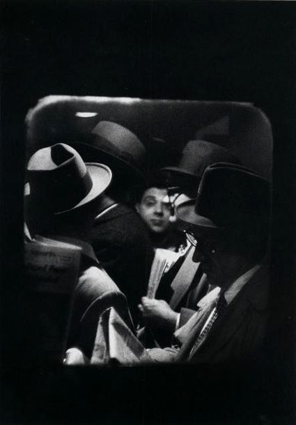 'Odd Man in',  Penn Station by Louis Stettner, 1958. | train | rush hour | business men | male | hats | suits | crowd | crowded