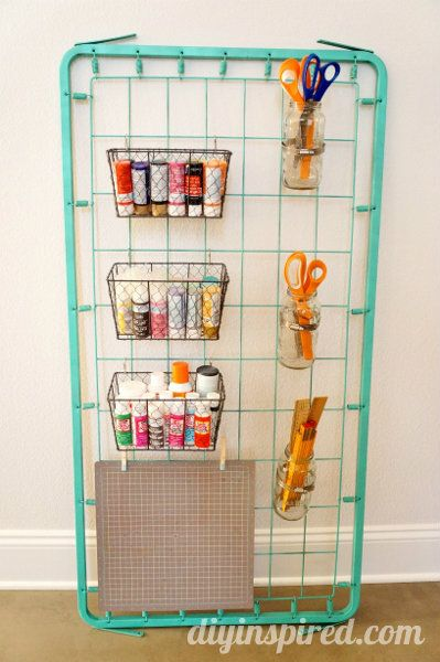 This is one of the coolest organization and upcycles we've come across.  Use an old bed spring as a genius way to store all of your craft supplies!