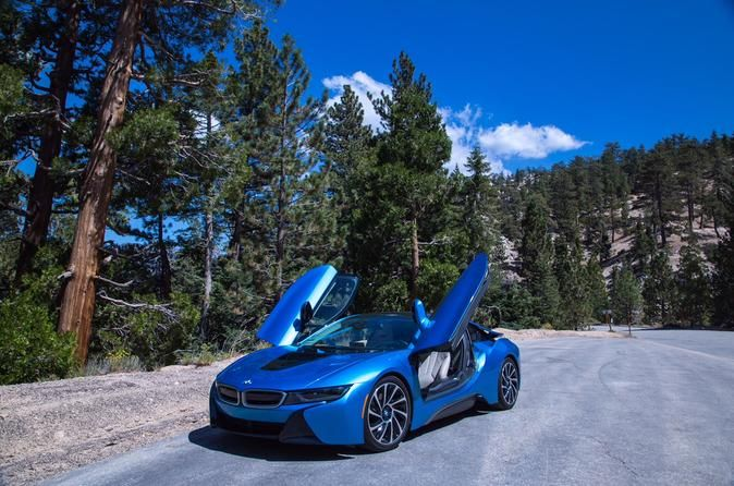 BMW i8 Angeles Forest Tour Drive a futuristic hybrid BMW i8through the most beautiful and famous roads of Los Angeles and Angeles National Forest. Follow your personal guide to enjoy breathtaking views and meet California in its amazing beauty.The tour begins in the heart of Hollywood on the Hollywood Walk of Fame. Shortly you will get to Barham Blvd. that will take you through Hollywood Hills to San Fernando Valley. Then you will get on the freeway on the way to Angeles Nat...