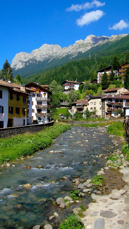 Moena with River Avisio and mountain background