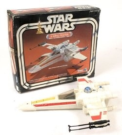 Star Wars X-Wing Fighter - wings snapped open, button made a laser sound, and light flashed in the front.  Held one figure in the cockpit.