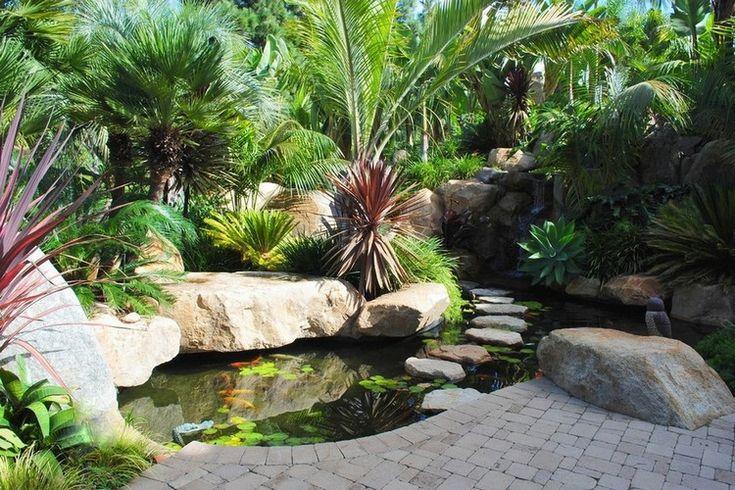 bassin carpe koï avec passage à gué, déco en pierre naturelle et pavage…