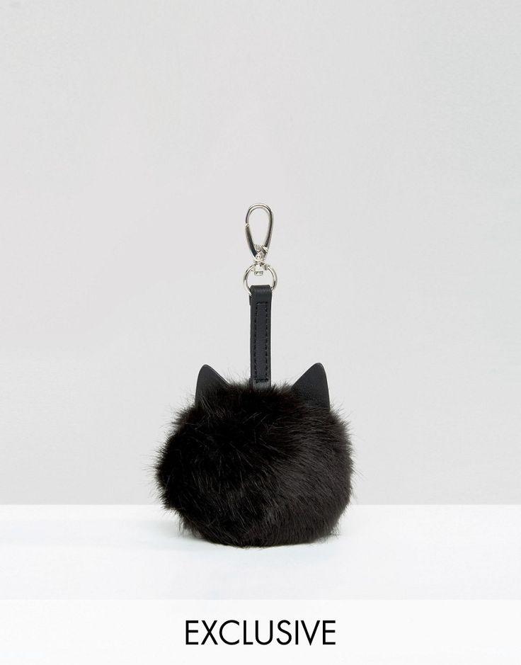 Imagen 1 de Charm de pompón para bolso con diseño de gato de Skinnydip