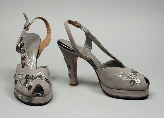 Pair of Woman's Sandals  Gainsborough Shoes (United States, Florida, Miami Beach)  United States, circa 1945  Costumes; Accessories  Suede, gilt leather, metal bosses, metallic paint  9 1/2 x 3 x 3 7/8 in. (24.13 x 7.62 x 9.84 cm) each  Gift of Mr. L. R. Smithline (AC1998.80.26.1-.2)  Costume and Textiles