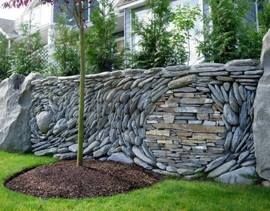 Rock Wall Garden Designs rock garden plants growing in stone crevices including alpines lewisia phlox sempervivum Creative Stacked Stone Wall Ideas