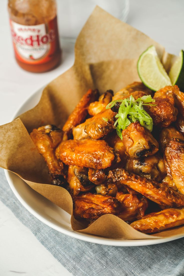 This chicken wings recipe only uses 4 ingredients, Redhot sauce, butter, Chicken wings and a spray of oil.