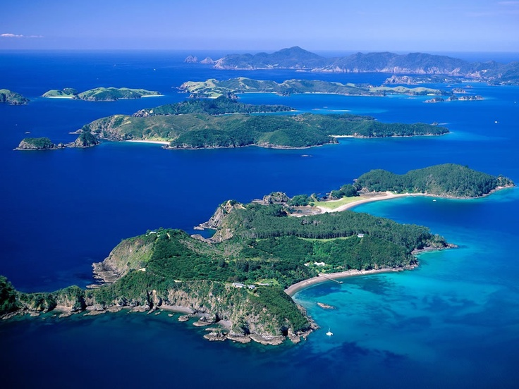 The Bay of Islands of New Zealand. Havens for international and local yachts; Tutukaka and Russell are game fishing hot spots; the beaches of Doubtless Bay are endlessly beautiful