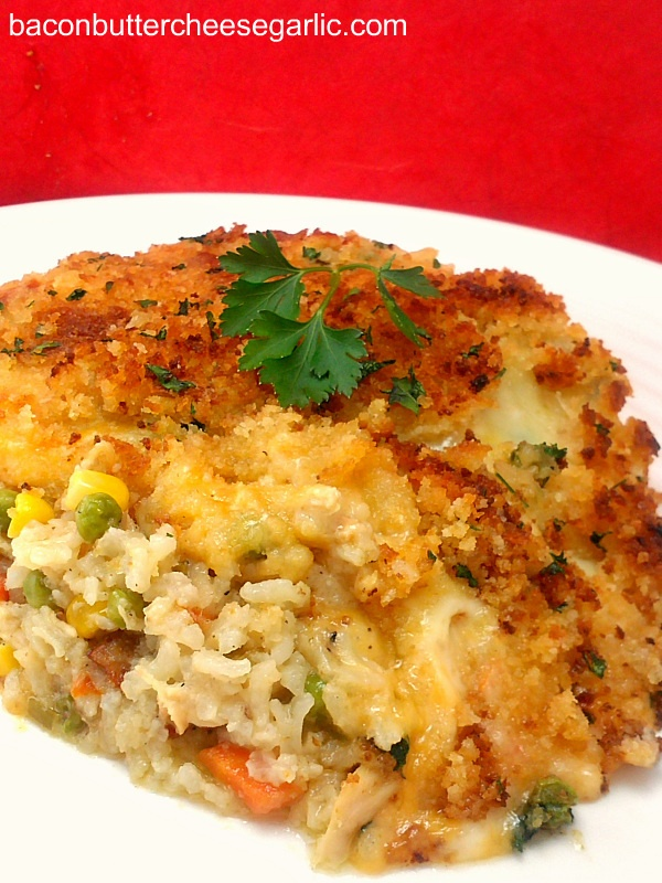 Confetti Casserole...with rice, chicken, corn & other veggies, bacon, mushrooms & shredded cheese.  All with a crunchy cracker crumb topping.  Yum!