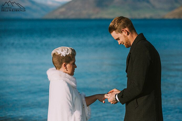 Queenstown 4wd wedding package with lakeside ceremony Bride and groom exchange vows