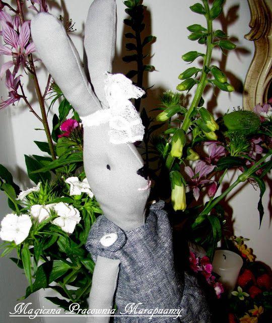 gray rabbit in flowers...