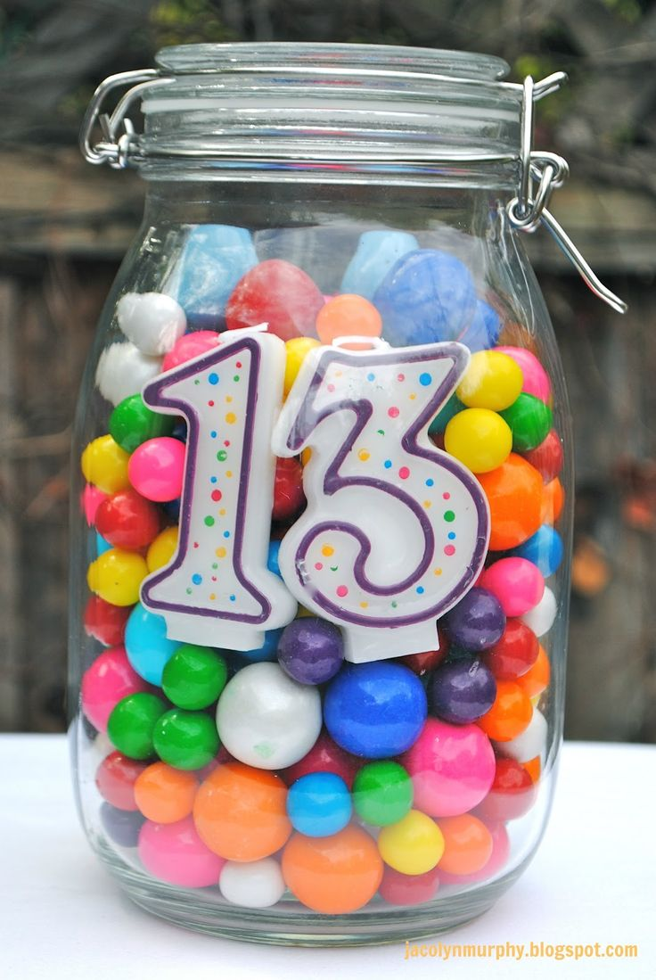 Birthday Centerpiece!!! Fill a jar with a number candle and gum or candy. Also, makes a great weight for a balloon bouquet!!!! #Love
