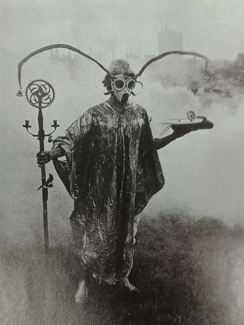 Creepy cult man with horns and a gas mask gif