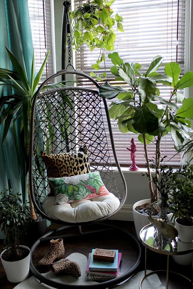"Pillow covers in leopard velvet and Chaing Mai Dragon Jade seen in the hanging chair in the ""boho eclectic"" living room of blogger Kimberly Hughes of Swoon Worthy"