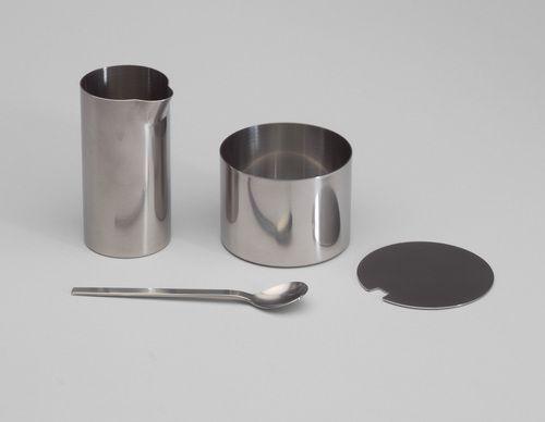 Cylinda Sugar Bowl and Creamer Arne Jacobsen (Danish, 1902–1971)  1964-67. Stainless steel, .1 (creamer): 3 3/4 x 2 (9.5 x 5.1 cm) .2 (sugar bowl): 2 1/8 x 3 (5.4 x 7.6 cm) .3 (spoon): 5 x 1 (12.7 x 2.5 cm). Manufactured by Stelton A/S, Copenhagen, Denmark. Gift of Stelton, USA