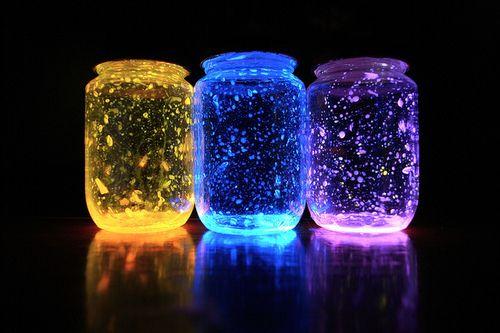 Three colored glowing jars