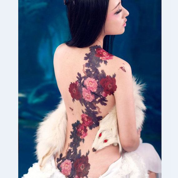 Large temporary tattoos sticker There are 2 tattoo stickers on model arm and back Size: 200 mm × 202 mm =7.87 in × 7.95 in Non-toxic Usually keeps