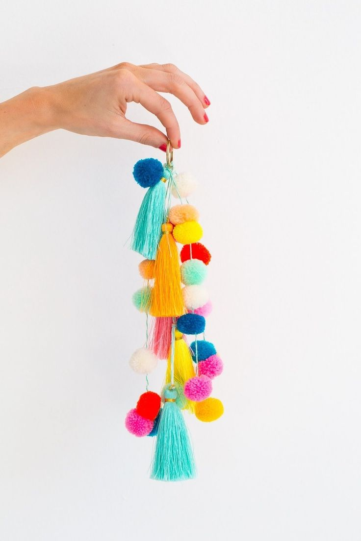 23 tassel DIY projects, like this colorful pom-pom tassel, to brighten up your home.
