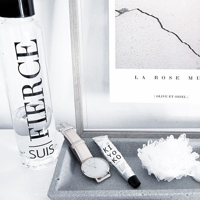 A whole lot of pretty with a decent dose of #fierce ✔️ Love this shot by the one and only @oliveetoriel. Glass water bottle. Desk inspiration. Office inspiration. Interior design.