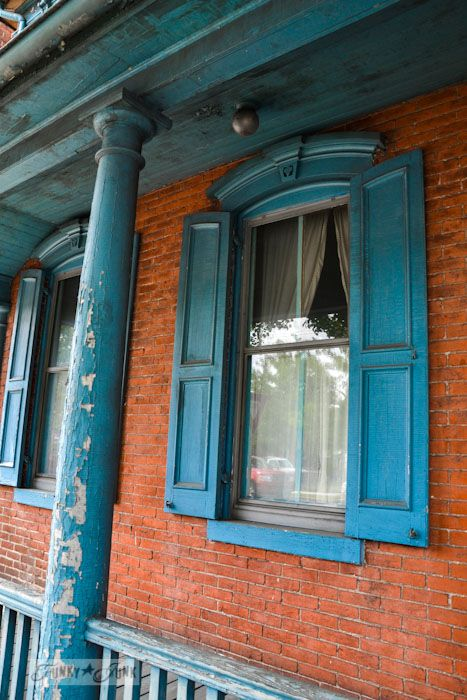 Touring historic Pennsylvania - beautiful old brick and blue shutters and pillars... what a fab colour combo! http://www.funkyjunkinteriors.net/ #historic #shutters #historicshutters