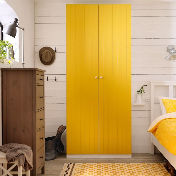 So cheerful! PAX white wardrobe with RISDAL yellow doors